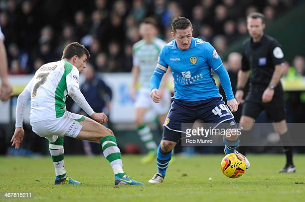 Ross McCormack of Leeds United in action against Kevin Dawson of Yeovil Town during the Sky Bet Championship match between Yeovil Town and Leeds...
