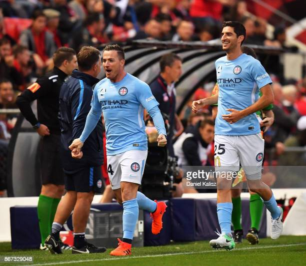 Ross McCormack of Melbourne City and Iacopo La Rocca of Melbourne City celebrate after the score of a goal during the round four ALeague match...