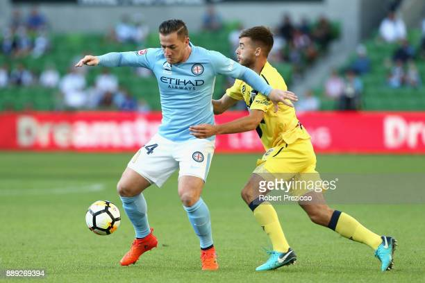 Ross McCormack of Melbourne City FC contests the ball during the round 10 ALeague match between Melbourne City FC and the Central Coast Mariners at...