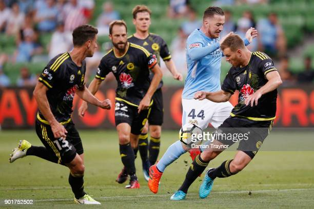 Ross McCormack of Melbourne City takes on the defence during the round 14 ALeague match between Melbourne City and the Wellington Phoenix at AAMI...