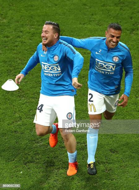 Ross McCormack of the City and Manny Muscat of the City warm up prior to the round five ALeague match between Melbourne City FC and Sydney FC at AAMI...