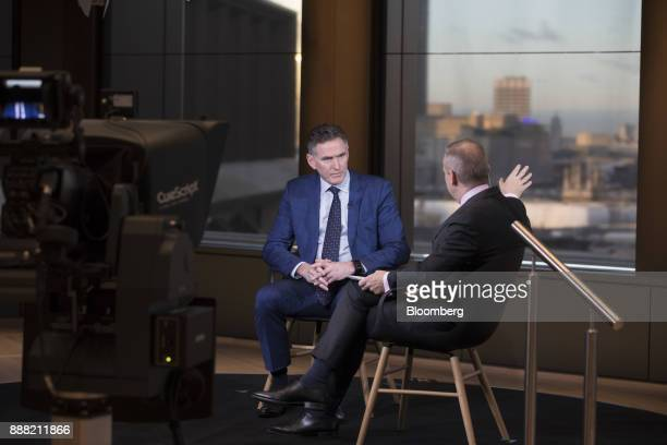 Ross McEwan chief executive officer of the Royal Bank of Scotland Group Plc left speaks with Manus Cranny anchor for Bloomberg Television during a a...