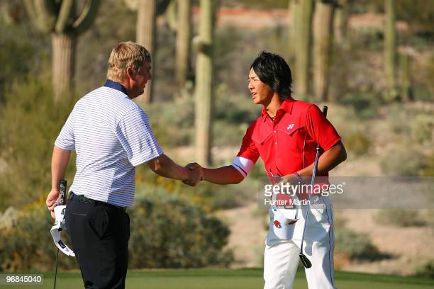 Ross McGowan of England congratulates Ryo Ishikawa of Japan on the 18th hole during round two of the Accenture Match Play Championship at the...