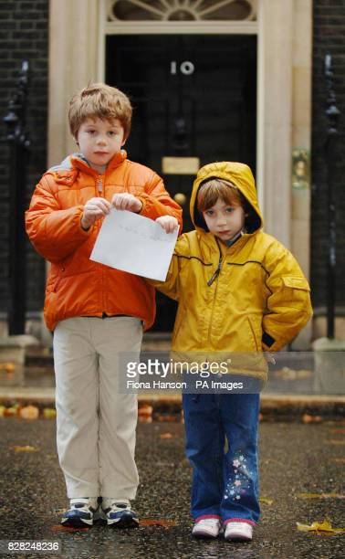 Ross Moncrieff and sister Ursula outside 10 Downing Street before handing handing in a letter they have written to the Prime Minister Tony Blair...