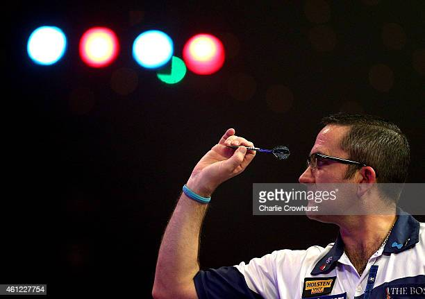 Ross Montgomery of Scotland in action during his quarter final match against Martin Adams of England during the BDO Lakeside World Professional Darts...