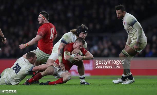 Ross Moriarity of Wales is tackled by Harry Williams and Sam Underhill during the NatWest Six Nations match between England and Wales at Twickenham...