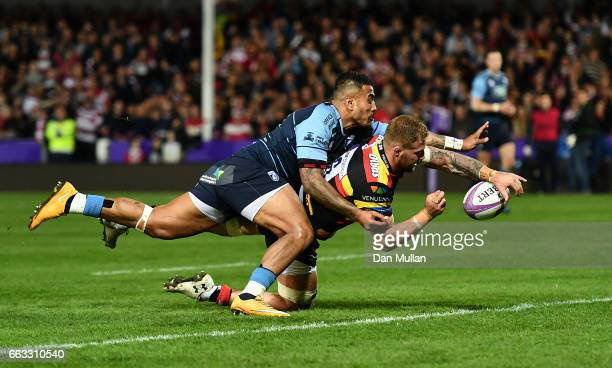 Ross Moriarty of Gloucester dives over to score his side's first try under pressure from Rey LeeLo of Cardiff Blues during the European Rugby...