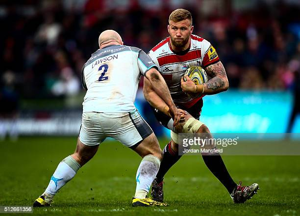 Ross Moriarty of Gloucester goes in for a challenge with Scott Lawson of Newcastle during the Aviva Premiership match between Gloucester Rugby and...