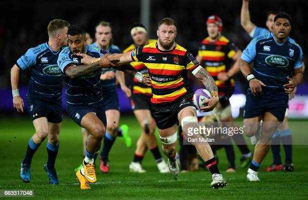 Ross Moriarty of Gloucester holds off Rey LeeLo of Cardiff Blues to score his side's first try during the European Rugby Challenge Cup quarter final...