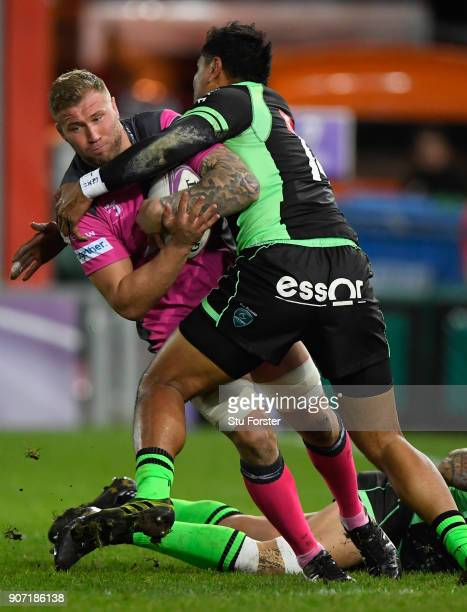 Ross Moriarty of Gloucester runs into the tackle of Frank Halai of Paloise during the European Rugby Challenge Cup match between Gloucester and...