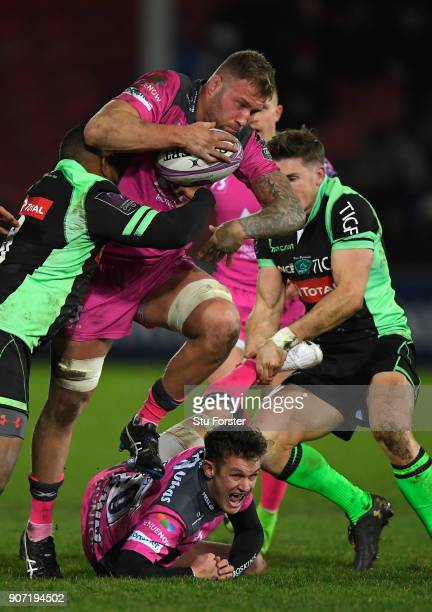 Ross Moriarty of Gloucester runs through the Paloise defence as Billy Burns reacts during the European Rugby Challenge Cup match between Gloucester...