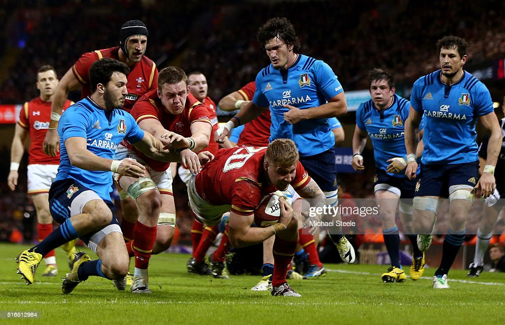 Ross Moriarty of Wales dives over to score his team's seventh try during the RBS Six Nations match between Wales and Italy at the Principality Stadium on March 19, 2016 in Cardiff, Wales.
