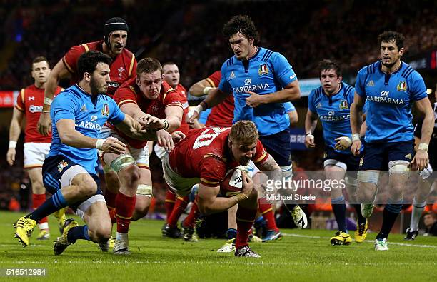 Ross Moriarty of Wales dives over to score his team's seventh try during the RBS Six Nations match between Wales and Italy at the Principality...