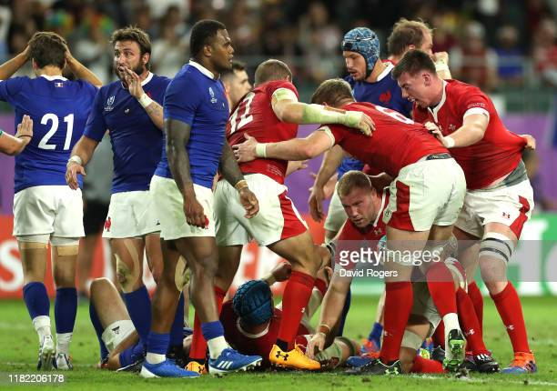 Ross Moriarty of Wales is congratulated by teammates after scoring his team's second try during the Rugby World Cup 2019 Quarter Final match between...
