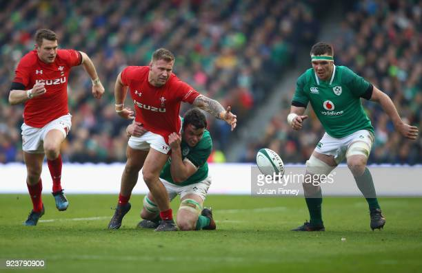 Ross Moriarty of Wales is tackled by James Ryan of Ireland during the NatWest Six Nations match between Ireland and Wales at Aviva Stadium on...