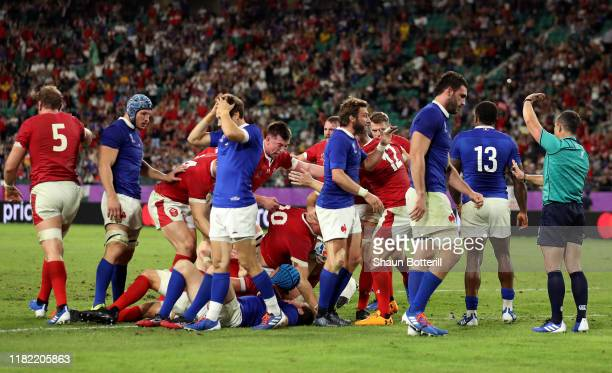 Ross Moriarty of Wales scores his sides second try as his teammates celebrate during the Rugby World Cup 2019 Quarter Final match between Wales and...