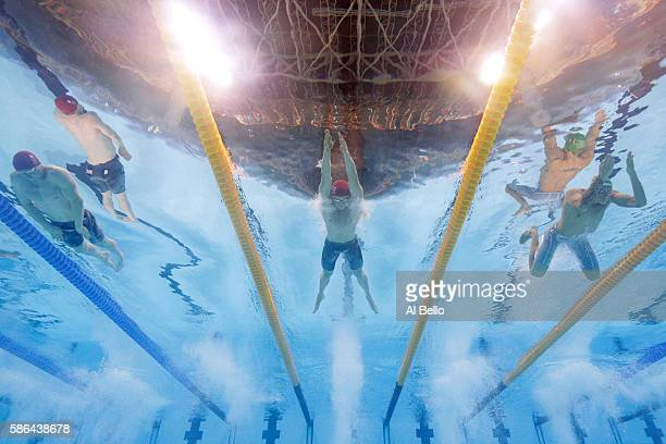 Ross Murdoch of Great Britain Adam Peaty of Great Britain and Giedrius Titenis of Lithuania compete in heat six of the Men's 100m Breaststroke on Day...