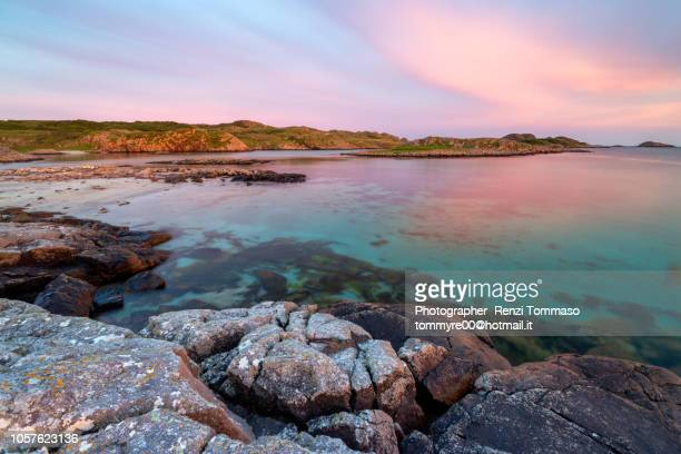 ross of mull sandy beach at sunset with clouds and crystal water - western isles stock pictures, royalty-free photos & images