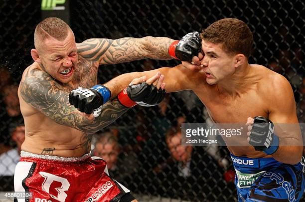 Ross Pearson of England and Al Iaquinta of the United States trade punches in their lightweight bout during the UFC Fight Night event inside...