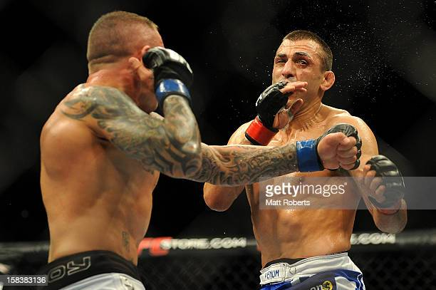 Ross Pearson punches George Sotiropoulos during the Lightweight bout between George Sotiropoulos and Ross Pearson at Gold Coast Convention and...
