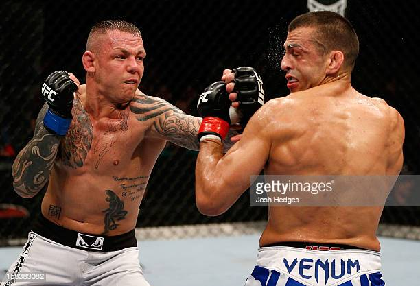 Ross Pearson punches George Sotiropoulos during their lightweight fight at the UFC on FX event on December 15 2012 at Gold Coast Convention and...