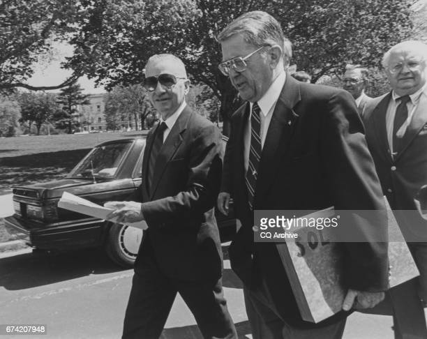 Ross Perot and Rep Gerald B H Solomon RNY walk over to a press conference in House regarding the AtoZ Spending Cuts Plan on April 21 1994