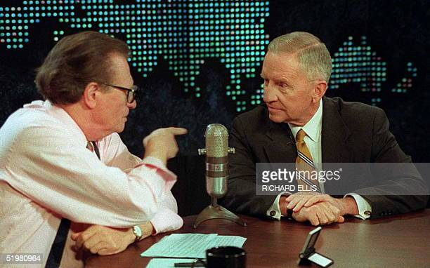 Ross Perot, Reform party candidate listens to CNN's Larry King live following the Presidential Debate in Washington, DC 06 October. King gave Ross...