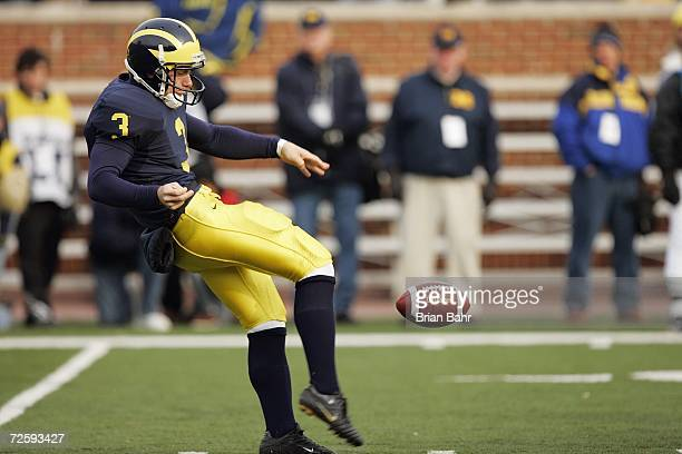 Ross Ryan of the Michigan Wolverines punts the ball during the NCAA game against the Ball State Cardinals on November 4 2006 at Michigan Stadium in...