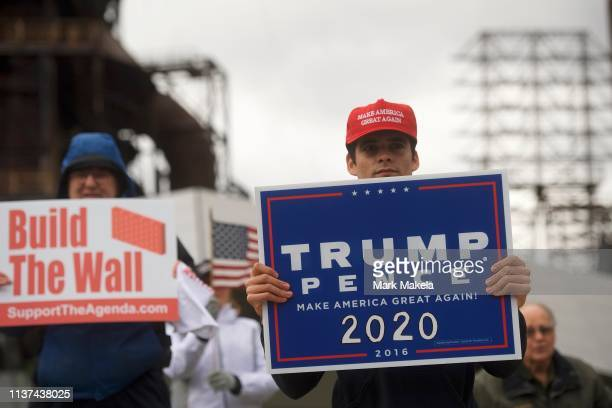 Ross Saveri joins fellow Donald Trump supporters demonstrating outside of a FOX News Town Hall with Democratic presidential candidate US Sen Bernie...