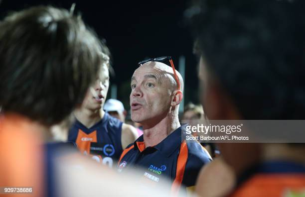 Ross Smith coach of the Calder Cannons speaks to his team during a quarter time break during the round two TAC Cup match between Calder and Eastern...