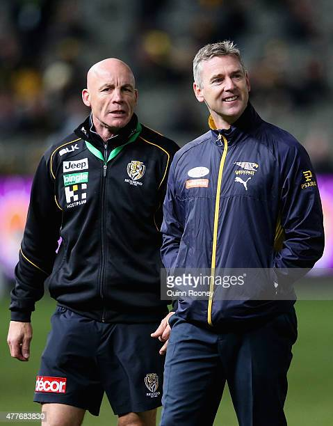 Ross Smith the assistant coach of the Tigers talks to Adam Simpson the coach of the Eagles during the round 12 AFL match between the Richmond Tigers...