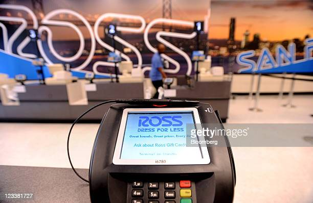 Ross Stores Inc. Signage is displayed on a card reading device at a location in San Francisco, California, U.S., on Wednesday, Aug. 31, 2011. Ross...