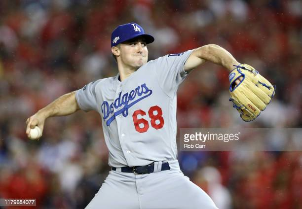 Ross Stripling of the Los Angeles Dodgers delivers against the Washington Nationals in the sixth inning of game four of the National League Division...
