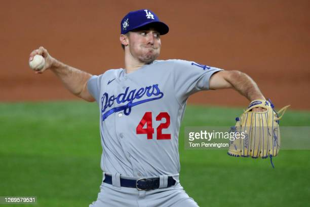 Ross Stripling of the Los Angeles Dodgers pitches against the Texas Rangers in the bottom of the first inning at Globe Life Field on August 29, 2020...