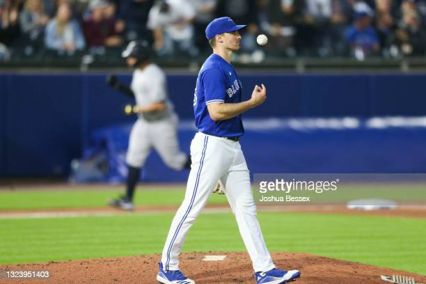 Ross Stripling of the Toronto Blue Jays reacts after a home run by Gary Sanchez of the New York Yankees during the seventh inning at Sahlen Field on...