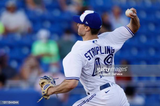 Ross Stripling of the Toronto Blue Jays throws a pitch during the first inning against the Los Angeles Angels during the season home opener at TD...