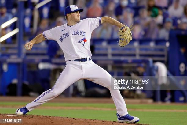 Ross Stripling of the Toronto Blue Jays throws a pitch during the fourth inning against the Los Angeles Angels during the season home opener at TD...