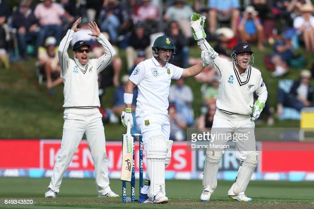 Ross Taylor and BJ Watling of New Zealand call for the dismissal of Dean Elgar of South Africa during day one of the First Test match between New...