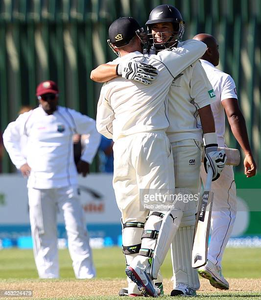 Ross Taylor and Brendon McCullum of New Zealand congratulate each other after both scoring centuries during day one of the first test match between...