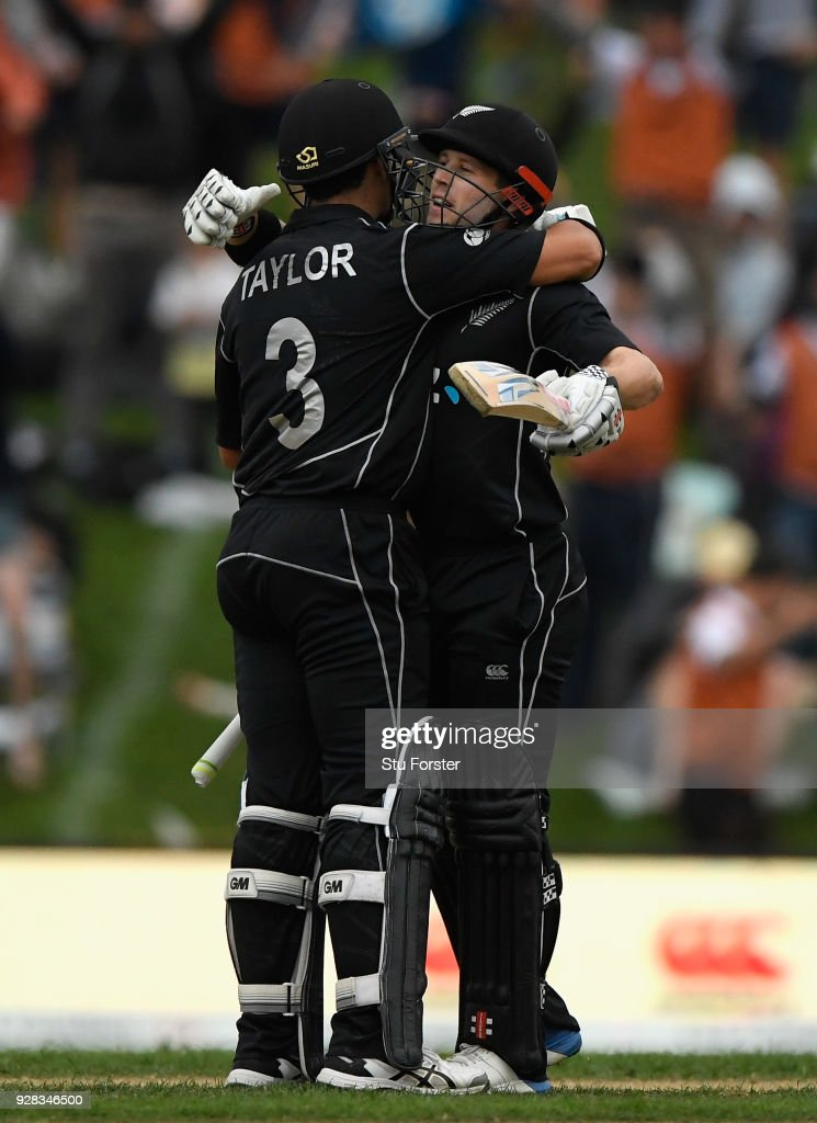 Ross Taylor (l) and Henry Nicholls celebrate the winning runs during the 4th ODI between New Zealand and England at University of Otago Oval on March 7, 2018 in Dunedin, New Zealand.