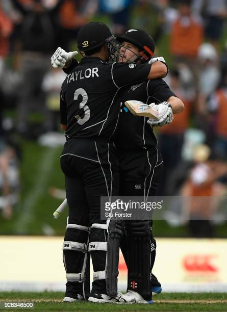Ross Taylor and Henry Nicholls celebrate the winning runs during the 4th ODI between New Zealand and England at University of Otago Oval on March 7...