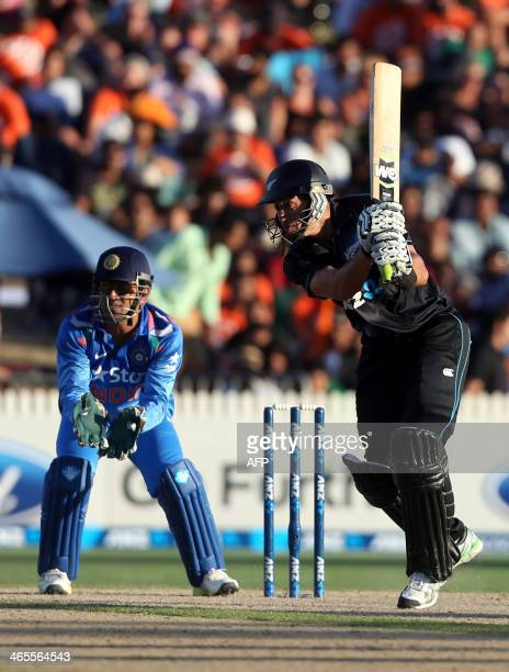 Ross Taylor of New Zealand bats as India's MS Dhoni looks on during the oneday international cricket match between New Zealand and India at Seddon...
