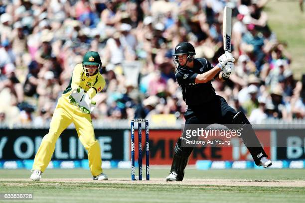 Ross Taylor of New Zealand bats as Peter Handscomb of Australia looks on during game three of the One Day International series between New Zealand...