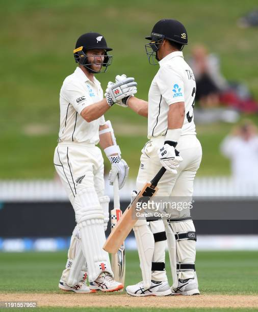 Ross Taylor of New Zealand celebrates his century with Kane Williamson during day 5 of the second Test match between New Zealand and England at...