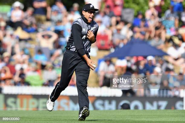 Ross Taylor of New Zealand celebrates taking a catch to dismiss Jason Mohammed of the West Indies during game one of the Twenty20 series between New...