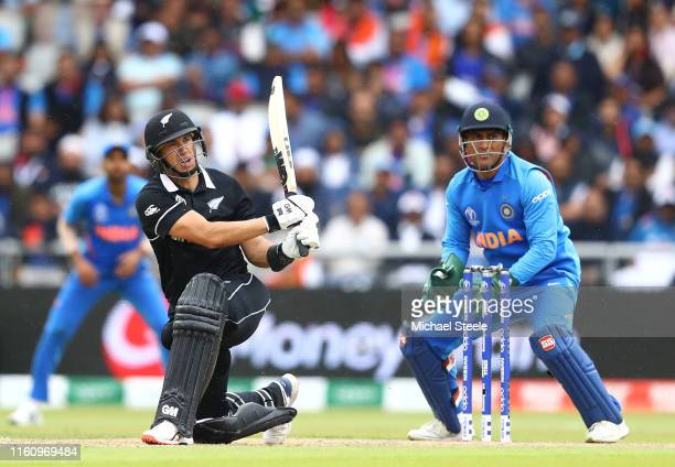 Ross Taylor of New Zealand hits a six over mid wicket to reach his half century during the SemiFinal match of the ICC Cricket World Cup 2019 between...