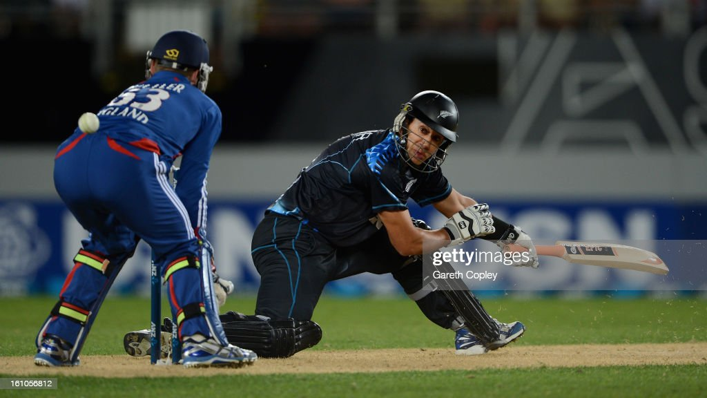 Ross Taylor of New Zealand hits past England wicketkeeper Jos Buttler during the 1st T20 International between New Zealand and England at Eden Park on February 9, 2013 in Auckland, New Zealand.