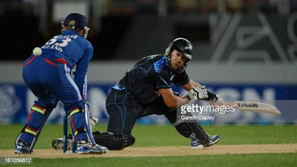 Ross Taylor of New Zealand hits past England wicketkeeper Jos Buttler during the 1st T20 International between New Zealand and England at Eden Park...