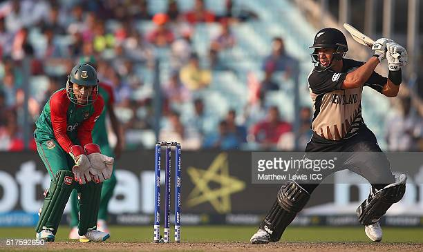 Ross Taylor of New Zealand hits the ball towards the bounadry as Mushfiqur Rahim of Bangladesh looks on during the ICC World Twenty20 India 2016...