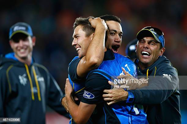 Ross Taylor of New Zealand hugs Trent Boult with Chris Donaldson following the 2015 Cricket World Cup Semi Final match between New Zealand and South...